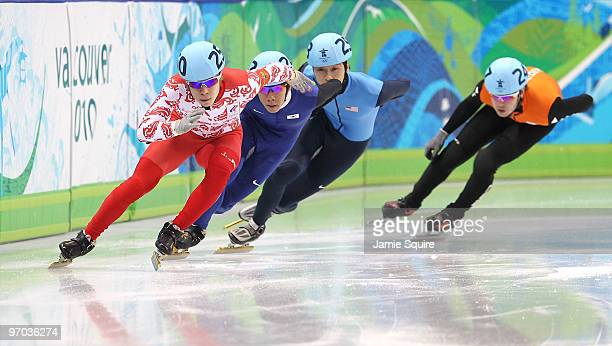 Semion Elistratov of Russia leads Lee HoSuk of South Korea Simon Cho of the United States and Sjinkie Knegt of Netherlands in the Short Track Speed...