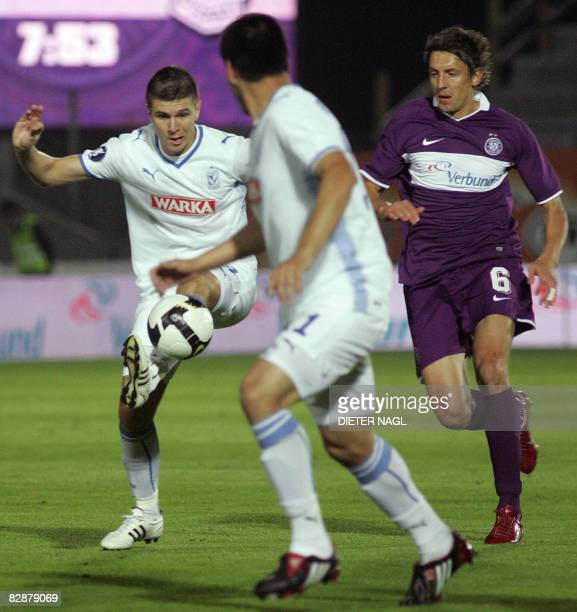 Semir Stilic of Lech Poznan fights for ball with Jacek Bak of Austria Wien during their UEFA Cup final round qualification football match on...