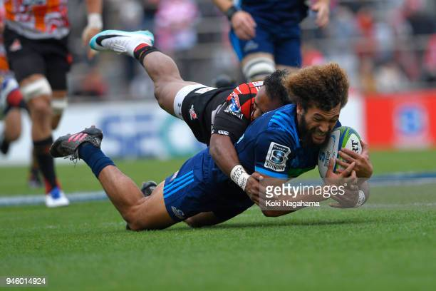 Semisi Masirewa of Sunwolves tmakes a tackle on Orbyn Leger during the Super Rugby Round 9 match between the Sunwolves and the Blues at the Prince...
