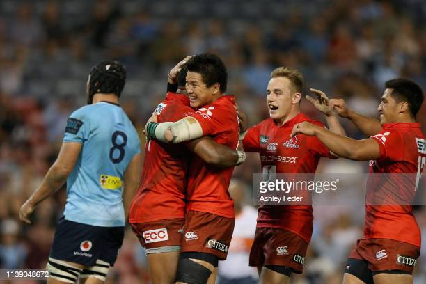 Semisi Masirewa of the Sunwolves celebrates his try with team mates during the round seven Super Rugby match between the Waratahs and the Sunwolves...