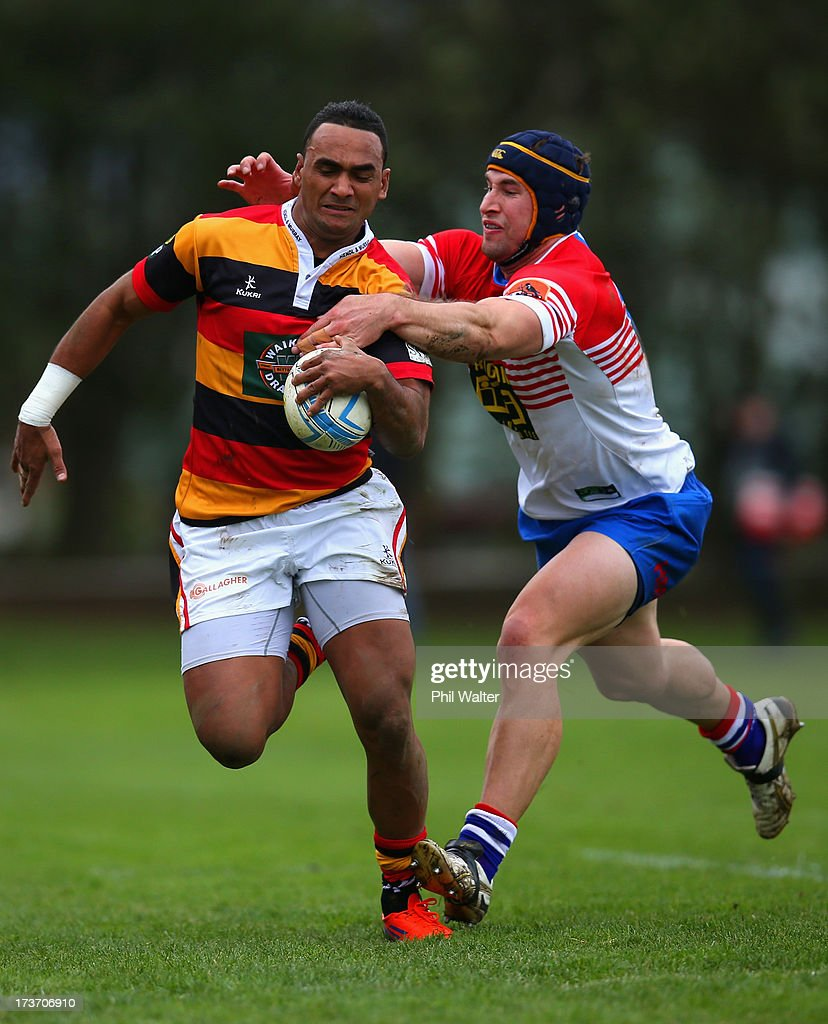 Semisi Masirewa of Waikato is tackled by David Thompson of Horowhenua-Kapiti during the Ranfurly Shield match between Waikato and Horowhenua-Kapiti at the Morrinsville Domain on July 17, 2013 in Morrinsville, New Zealand.