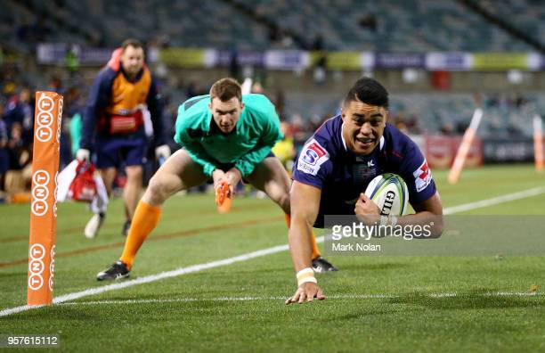 Semisi Tupou of the Rebels dives to score a try during the round 12 Super Rugby match between the Brumbies and the Rebels at GIO Stadium on May 12...