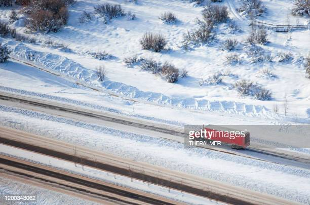 semi-truck aerial shot colorado usa - haulage stock pictures, royalty-free photos & images