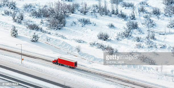 semi-truck aerial shot - driving in snow stock photos and pictures
