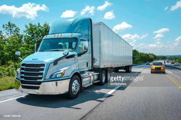 semi-truck blue daycab 18 wheeler on the highway - autonomous technology stock pictures, royalty-free photos & images