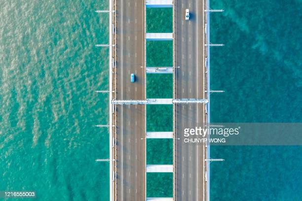semi-truck crossing oresund bridge - big bulge stock pictures, royalty-free photos & images