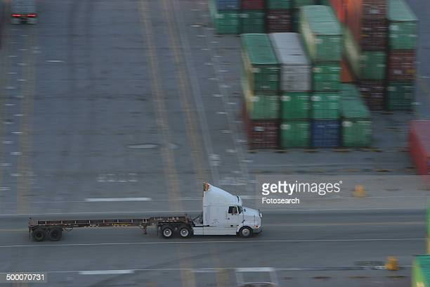 Semi-truck driving in cargo storage area