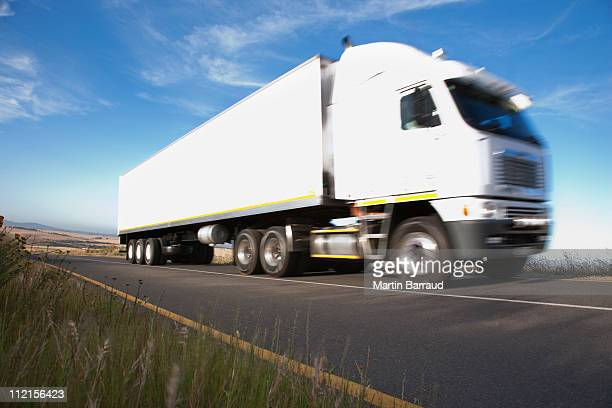 Semi-truck driving on remote road