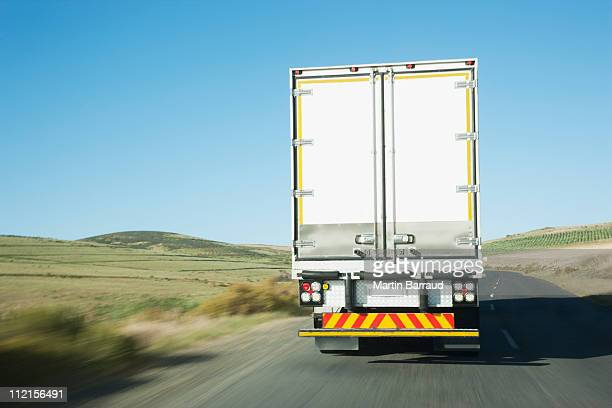 Semi-truck driving on remote rode