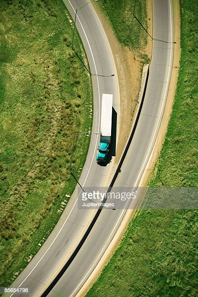 Semi-truck driving on rural highway