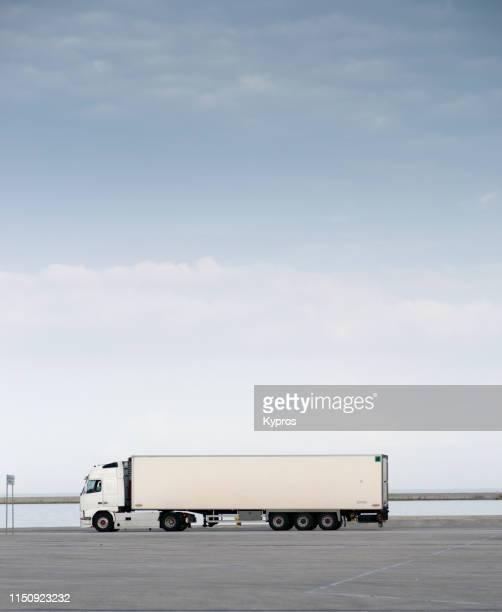 semi-truck driving - patras port, greece - lkw stock-fotos und bilder