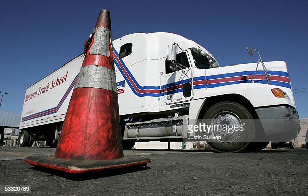 A semitruck manuevers around a traffic cone during training at the Western Trucking School August 3 2005 in Turlock California According to the...