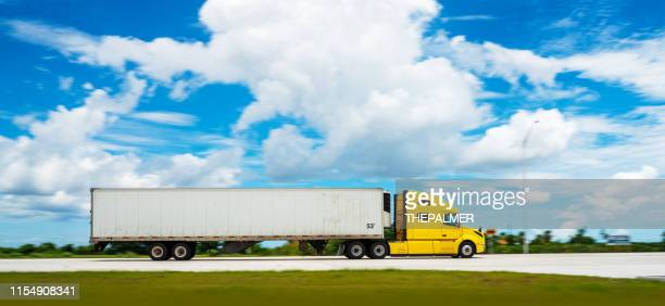 semi-truck on the highway - semi truck stock pictures, royalty-free photos & images