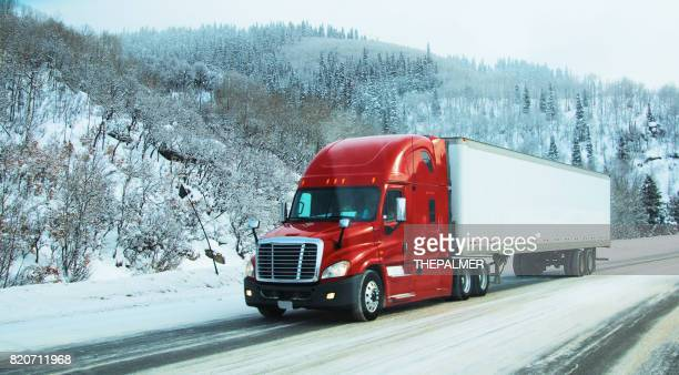 semi-truck on winter - driving in snow stock photos and pictures