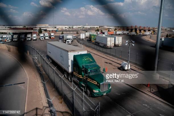 Semi-trucks cross the border at the Zaragoza International Bridge, in Juarez, Mexico, across the border from El Paso, Texas on May 31, 2019. -...