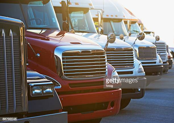 semi-trucks in a row - commercial land vehicle stock pictures, royalty-free photos & images