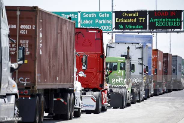 Semitrucks wait in line to enter the APM shipping terminal at the Port of Los Angeles in Los Angeles California US on Tuesday May 7 2019 The terminal...