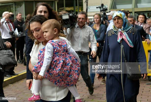 Semiya Simsek daughter of NSU victim Enver Simsek leaves with her child the court after the proclamation of sentence in the trial against Beate...
