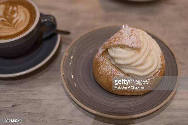semla (plural semlor) are cream buns, with almond paste, traditionally eaten on, or before, shrove tuesday in sweden / scandinavia. also known as fastlagsbulle, laskiaispulla, vastlakukkel, fastelavnsbolle - pancake day stock pictures, royalty-free photos & images