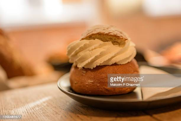 semla (plural semlor) are cream buns, with almond paste, traditionally eaten on, or before, shrove tuesday in sweden / scandinavia. also known as fastlagsbulle, laskiaispulla, vastlakukkel, fastelavnsbolle - tuesday stock pictures, royalty-free photos & images