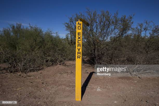 A Sempra Energy marker reads'Do Not Dig' in the village of Loma de Bacum Sonora state Mexico on Tuesday Dec 5 2017 Sempra Energy's natural gas...