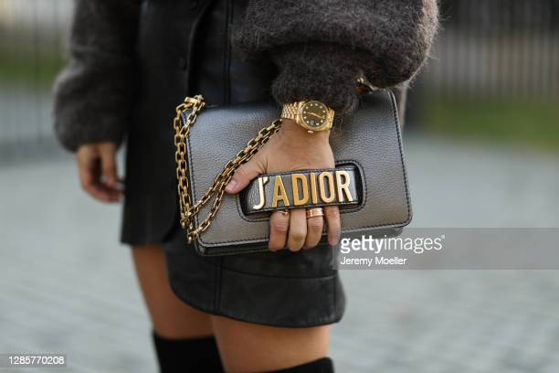 Semra Hunt wearing Dior bag, American Vintage sweater, Ganni black skirt on November 13, 2020 in Hamburg, Germany.