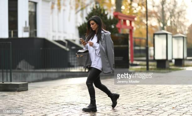 Semra Hunt wearing Hermes bag, Blaze blazer, Agl black boots, Zara leather pants on November 13, 2020 in Hamburg, Germany.