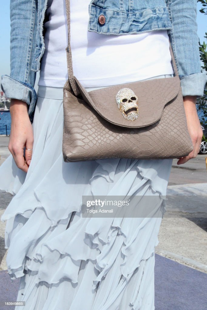 Semra Sen wears Three People skirt and a Home Store bag during Mercedes-Benz Fashion Week Istanbul s/s 2014 presented by American Express on October 10, 2013 in Istanbul, Turkey.