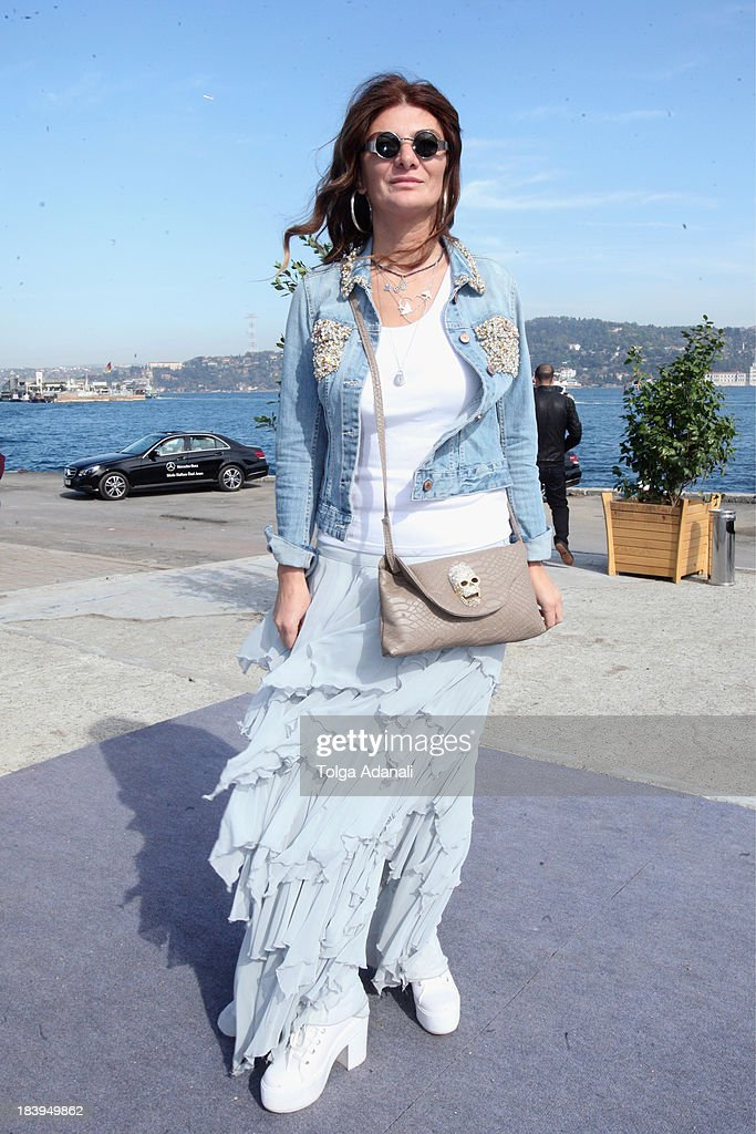 Semra Sen wears Three People skirt and shoes and a Home Store bag during Mercedes-Benz Fashion Week Istanbul s/s 2014 presented by American Express on October 10, 2013 in Istanbul, Turkey.