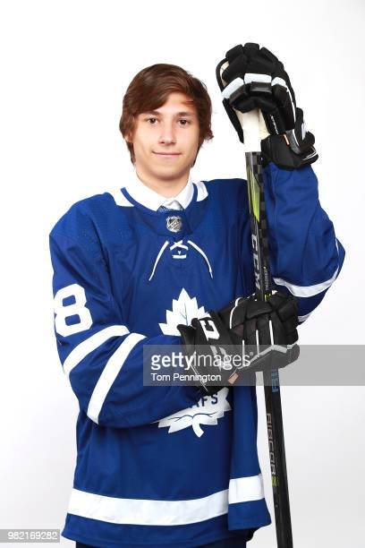 Semyon DerArguchintsev poses after being selected 76th overall by the Toronto Maple Leafs during the 2018 NHL Draft at American Airlines Center on...