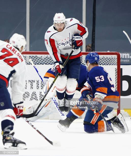 Semyon Varlamov and Casey Cizikas of the New York Islanders defend against John Carlson and T.J. Oshie of the Washington Capitals during the second...