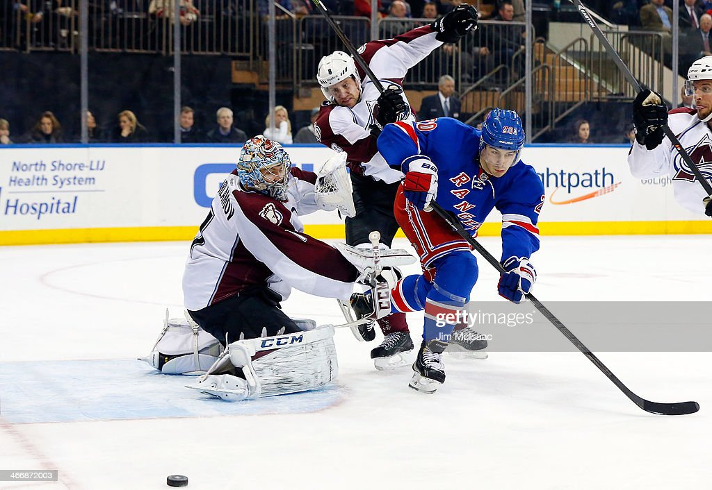 Semyon Varlamov #1 and Jan Hejda #8 of the Colorado Avalanche defend a third-period scoring chance against Chris Kreider #20 of the New York Rangers at Madison Square Garden on February 4, 2014 in New York City.