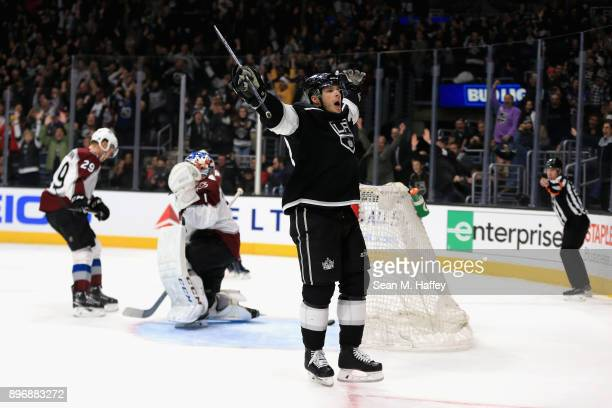 Semyon Varlamov and Nathan MacKinnon of the Colorado Avalanche look on after Dustin Brown of the Los Angeles Kings scores the winning goal in...