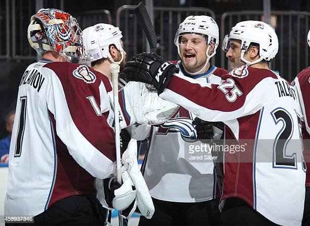 Semyon Varlamov John Mitchell and Maxime Talbot of the Colorado Avalanche celebrate after a 43 win over the New York Rangers in a shootout at Madison...