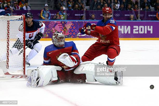 Semyon Varlamov of Russia makes a save against Slovakia during the Men's Ice Hockey Preliminary Round Group A game on day nine of the Sochi 2014...