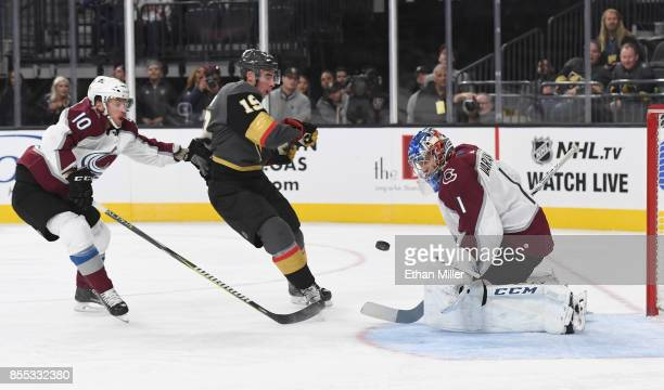 Semyon Varlamov of the Colorado Avalanche blocks a shot by Reilly Smith of the Vegas Golden Knights as Sven Andrighetto of the Avalanche defends...