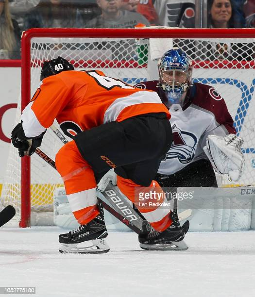 Semyon Varlamov of the Colorado Avalanche guards his net as the loose puck ends up in the skates of Jordan Weal of the Philadelphia Flyers on October...