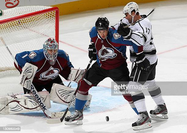 Semyon Varlamov of the Colorado Avalanche looks on as Shane O'Brien fights for position against Ethan Moreau of the Los Angeles Kings at the Pepsi...