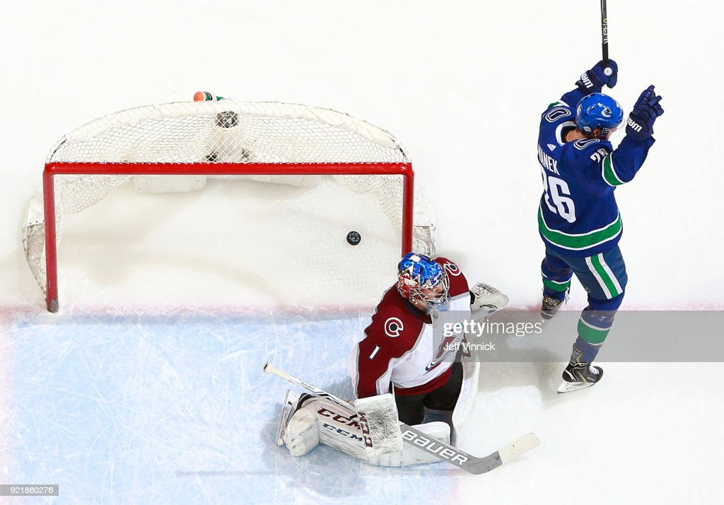 Semyon Varlamov #1 of the Colorado Avalanche looks on as Thomas Vanek #26 of the Vancouver Canucks celebrates a Vancouver goal during their NHL game at Rogers Arena February 20, 2018 in Vancouver, British Columbia, Canada. Colorado won 5-4.