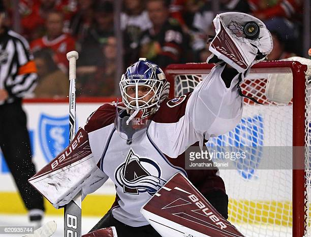 Semyon Varlamov of the Colorado Avalanche makes a glove save against the Chicago Blackhawks at the United Center on November 3 2016 in Chicago...