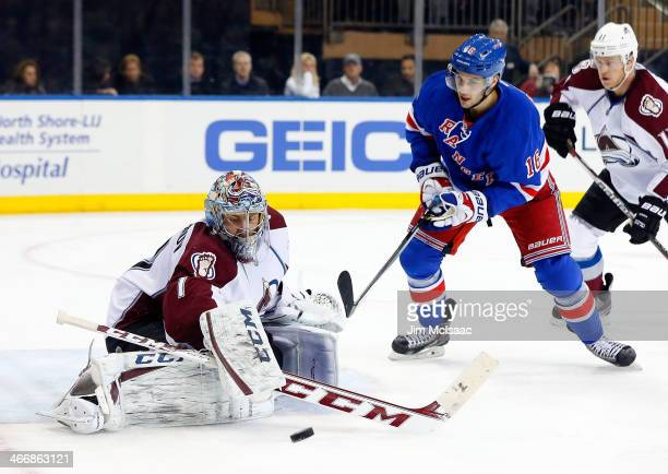 Semyon Varlamov of the Colorado Avalanche makes a save in the second period under pressure from Derick Brassard of the New York Rangers at Madison...
