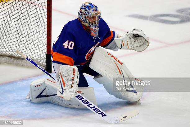 Semyon Varlamov of the New York Islanders blocks a shot during warmups before Game Four of the Stanley Cup Semifinals against the Tampa Bay Lightning...