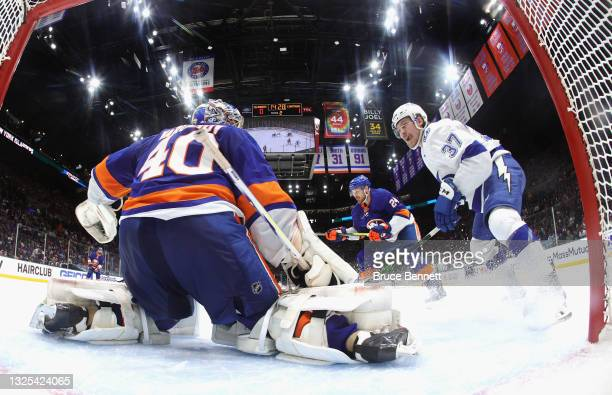 Semyon Varlamov of the New York Islanders defends the net against Yanni Gourde of the Tampa Bay Lightning in Game Six of the NHL Stanley Cup...