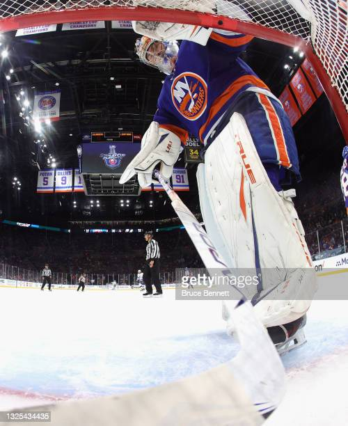Semyon Varlamov of the New York Islanders fishes a puck out of the net following a Tampa Bay Lightning goal in Game Six of the NHL Stanley Cup...