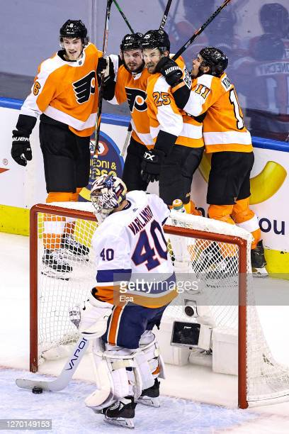 Semyon Varlamov of the New York Islanders is congratulated by his teammates after scoring a goal past Semyon Varlamov of the New York Islanders...