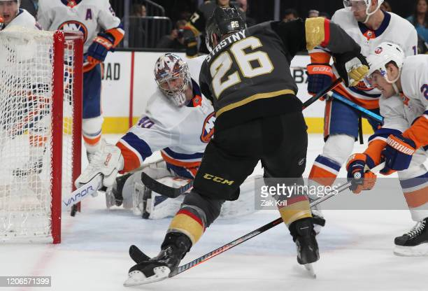 Semyon Varlamov of the New York Islanders makes a diving save on a shot by Paul Stastny of the Vegas Golden Knights during the second period at...