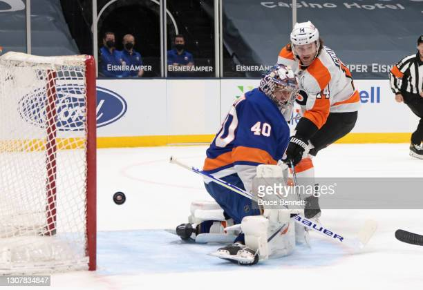 Semyon Varlamov of the New York Islanders makes the first period stop on Sean Couturier of the Philadelphia Flyers at the Nassau Coliseum on March...