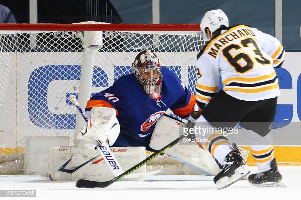 Semyon Varlamov of the New York Islanders stops a shootout attempt from Brad Marchand of the Boston Bruins to secure the teams 2-1 victory against...