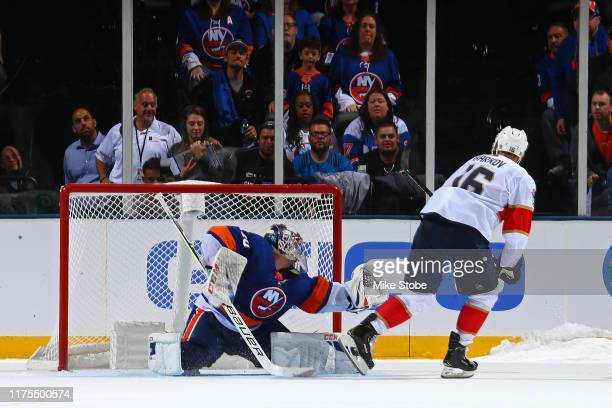 Semyon Varlamov of the New York Islanders stops a shot from Aleksander Barkov of the Florida Panthers the 3-2 shootout win for the New York Islanders...