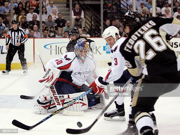 Semyon Varlamov of the Washington Capitals makes a save on the shot of Ruslan Fedotenko of the Pittsburgh Penguins in the first period at Mellon...